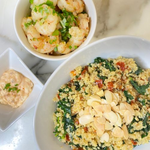 Kale quinoa bowl with honey lime shrimp and spicy mayo
